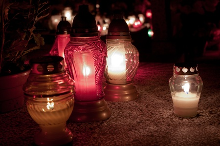 smolder: Candles on the graves Stock Photo