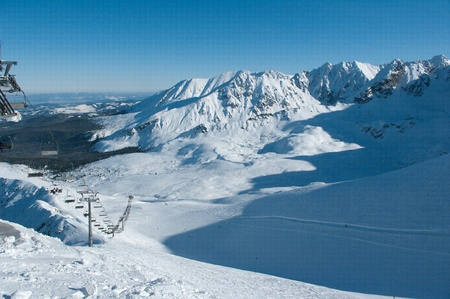 Ski lift and chair lift to the ground and stunning Tatra Mountains photo