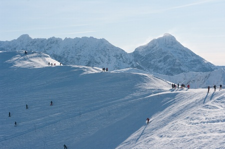 Tatra Mountains, skiers and tourists. photo