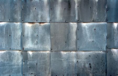A wall covered with sheet metal  photo