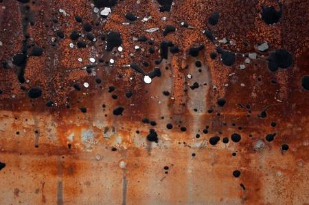 Rust on metal and tar