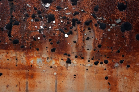 Rust on metal and tar