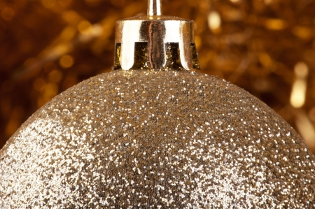 Golden bauble on a gold background   photo