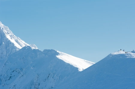 People on the snow-covered peaks of the Tatra mountains  photo