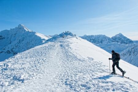 A man wandering through the mountains  Standard-Bild