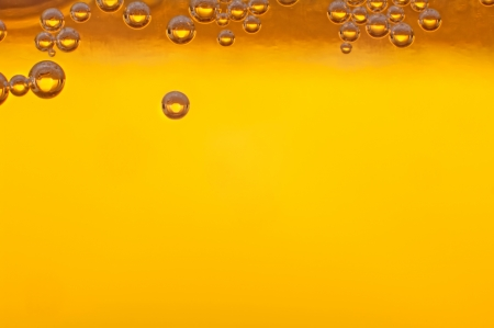 Beer bubbles in the high magnification and close-up. photo