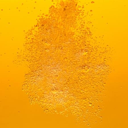 Lots of golden beer bubbles.