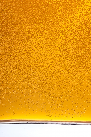 Lots of golden beer bubbles photo