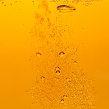 Lots of golden beer bubbles photo