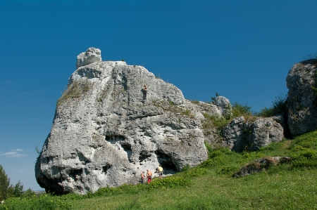 High rocks on which people climb. photo