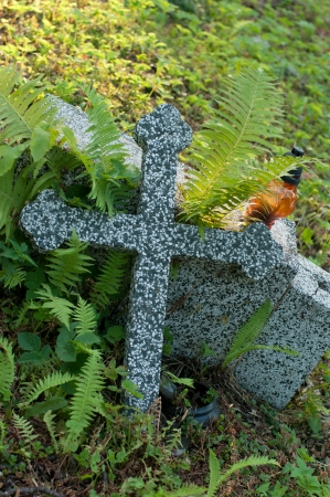 Old cross on the grave. photo