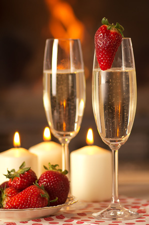 Champagne, strawberries and candles for a romantic evening.