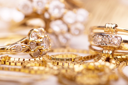 trinkets: Gold jewelry for elegant women. Stock Photo