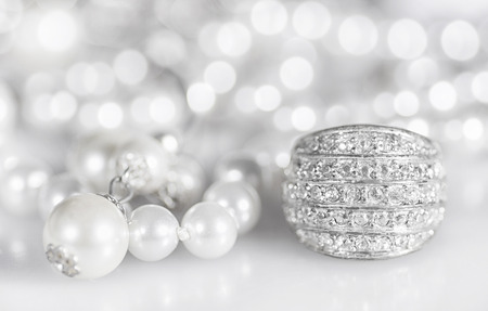 Silver jewelry with pearls and diamonds. Stock Photo