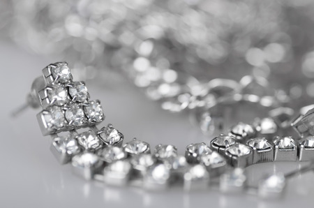 silver jewelry: Silver earring with diamonds and silver jewelry.