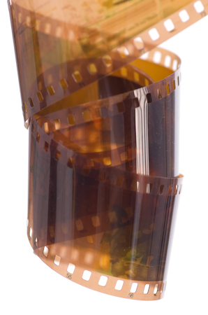 A roll of photographic film of 135 mm on a white background.