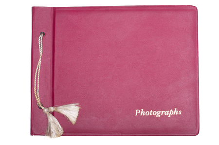 Old photo album in red leather cover.