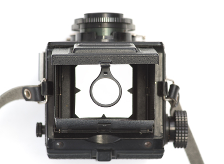 The viewfinder of an old, dual-lens reflex camera with a magnifying glass na białym tle. Standard-Bild - 115234772