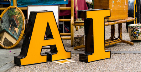Big yellow letters A and I at antique market in Italy photo