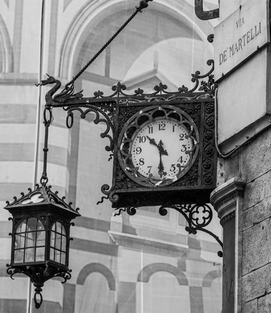 corner clock: Old clock in a corner of piazza duomo, cathedral plaza, in Florence