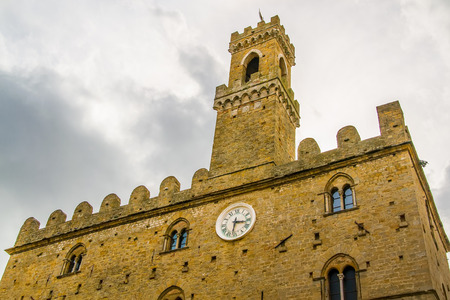 volterra: Top part of Palace of Priori in Volterra (Italy)