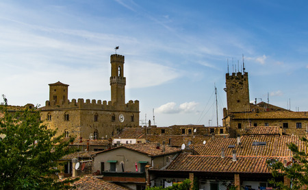 volterra: The roofs of Volterra, Italy. Palace of Priori is clearly visible. Editorial