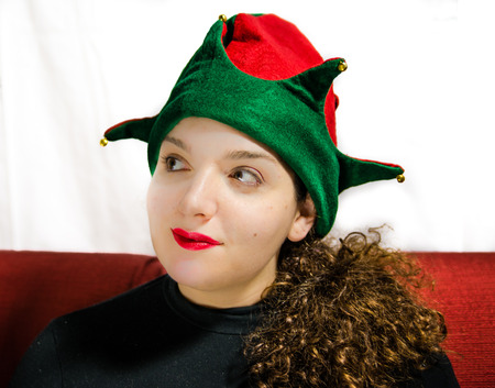 waiting glance: Beautiful girl portrait with green and red christmas elf hat