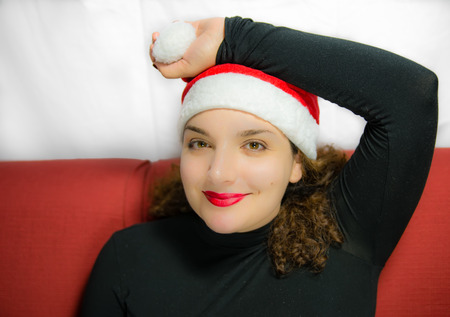 waiting glance: Beautiful girl portrait with Santa Claus hat with happy expression