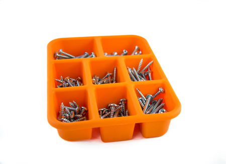 compartments: Orange box of screws with different compartments on a white background