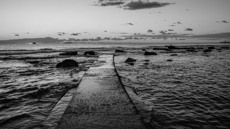 leghorn: Black and white sunset on the Tuscany sea in front of Leghorn Stock Photo