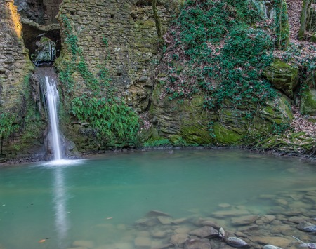mill valley: Ruins of a water mill in Tuscany with a waterfall That passes through