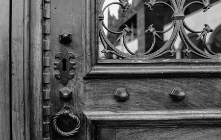Ancient door lock made of iron and wood with an ornament photo
