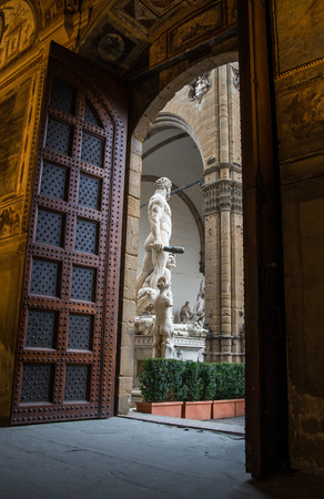 foreshortening: Beautiful foreshortening of Piazza Signoria statue from the main entrance of Palazzo Vecchio in Florence Editorial
