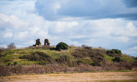 friaries: Little hill with the ruins of a church under a beautiful sky