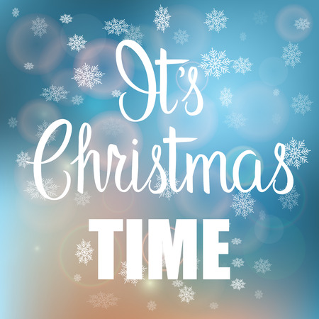 it's: Its Christmas Time handwritten text on blurred background with snowflakes.Calligraphic Xmas and New Year holidays design.