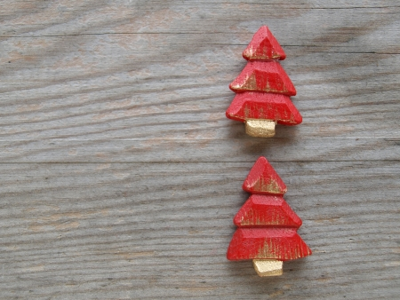 red Christmas trees on wood photo
