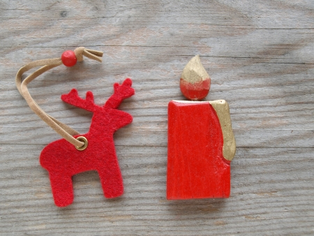 red reindeer and candle on wooden board photo