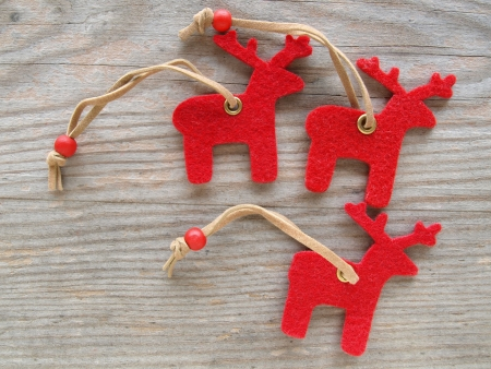 red reindeers on wooden board photo