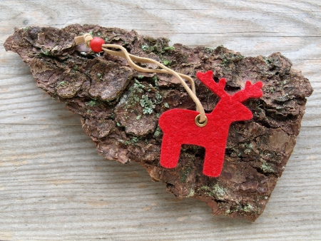 red reindeer on a bark and wooden board photo