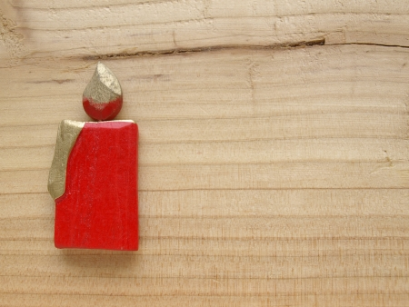 red candle on wood photo