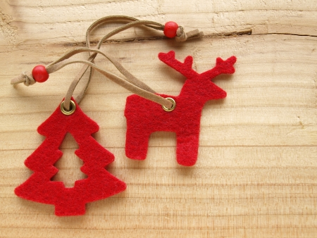 red reindeer and Christmas tree on wood photo