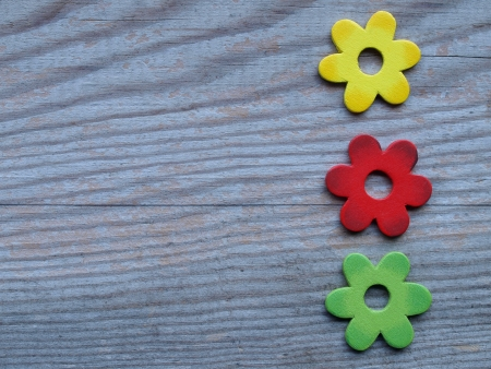 colorful wooden flowers on a board