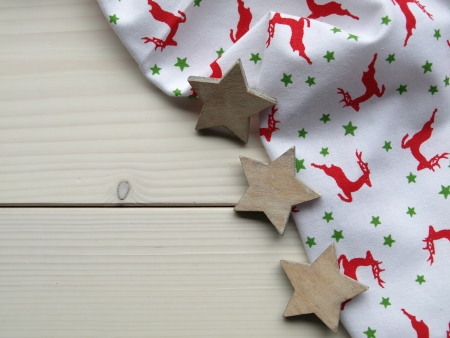 wooden background with fabric and stars photo