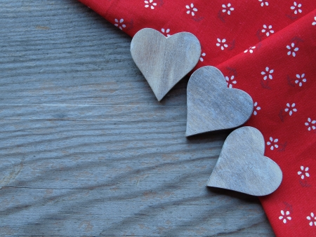 wooden background with fabric and hearts photo