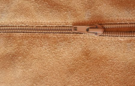 Close up shot of a zipper on a leather background photo