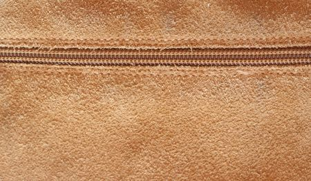 Close up shot of a zipper on a leather background Stock Photo - 5857451