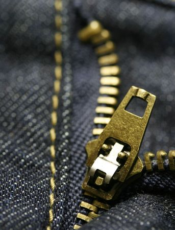 Macro shot of a zipper from blue jeans. Stock Photo