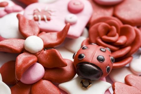 Macro shot of various pink and happy decorations made from clay.