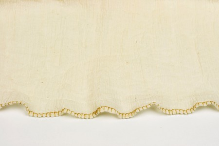 Macro shot of a tan dress fabric background.