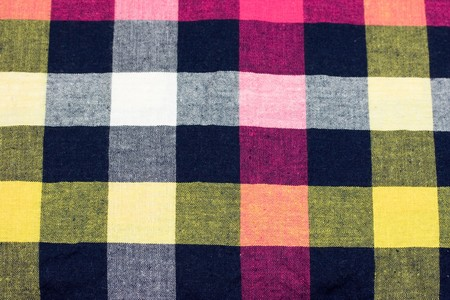 Macro shot of a colorful chequered fabric.